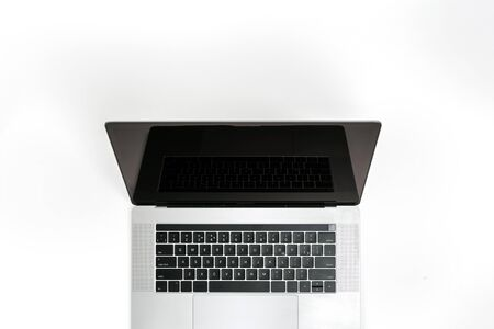 Open laptop with blank screen on a white background top view