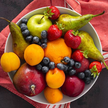 Fruits plate on a dark background top view