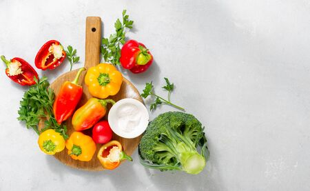 Fresh colorful mix homemade peppers on white background top view. Flat lay, copy space Фото со стока