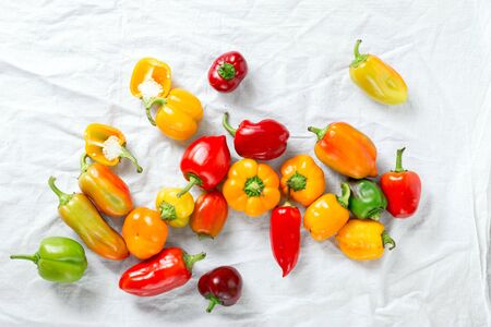 Homemade pepper scattered on a white background