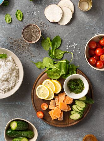 Ingredients for preparation poke bowl with salmon, avocado, vegetables and chia seeds top view