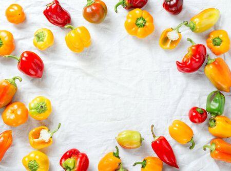 Frame of assortment of fresh homemade pepper on white background