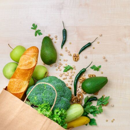 Shopping bag food with healthy food on a wooden background with copy space top view