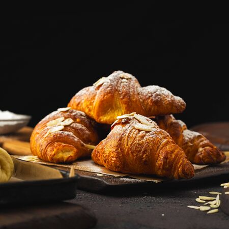 Breakfast croissant with chocolate on a dark stone background 스톡 콘텐츠