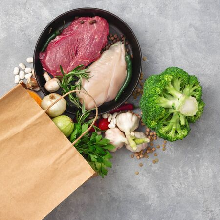 Bag food concept. Groceries shopping paper bag with healthy food top view