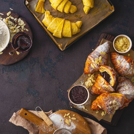 Breakfast croissant with chocolate on a dark stone background top view 스톡 콘텐츠