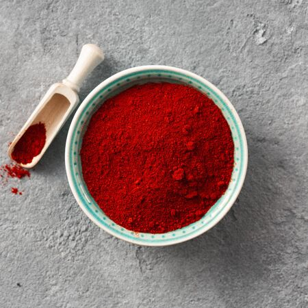 Chili pepper powder on concrete background with free space for text top view 写真素材