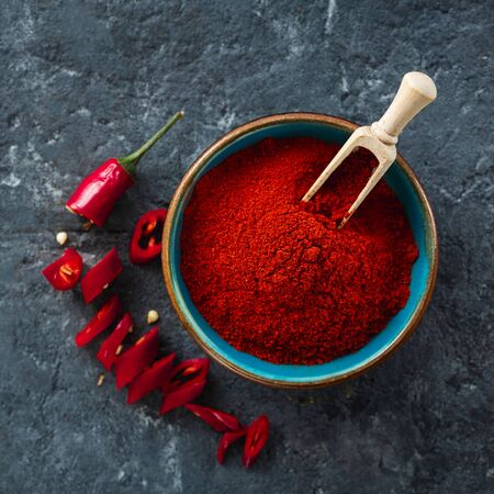 Chili pepper powder on dark background with copy space top view 写真素材