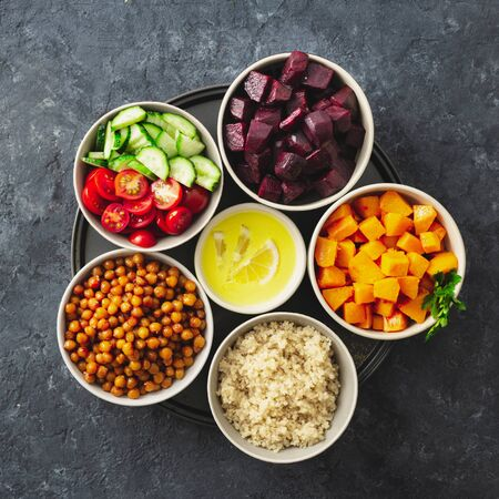 Healthy vegetarian ingredients for cooking moroccan salad. Chickpeas, Baked pumpkin and beets, quinoa and vegetables top view copy space