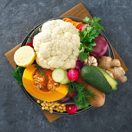 Ingredients for cooking vegetarian Indian dish aloo gobi top view. Healthy food Stok Fotoğraf