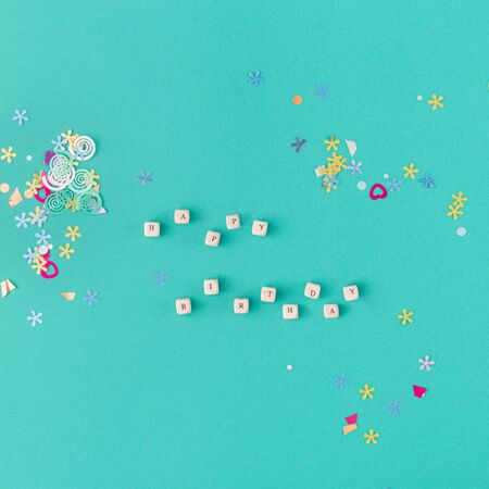 Happy birthday word with colorful confetti top view
