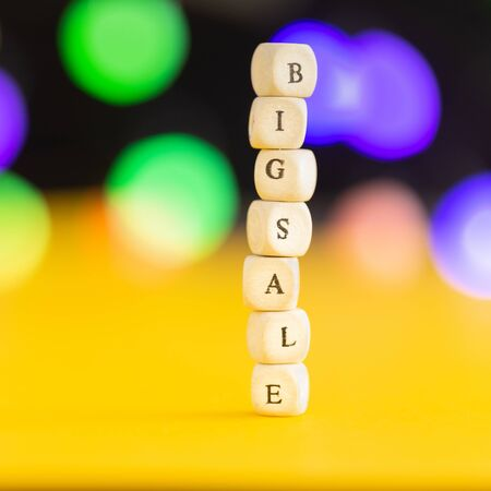 Creative idea for sale shopping. Big sale word on colorful blur bokeh background with copy space Foto de archivo