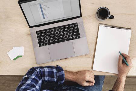 Online Education or online courses concept. Man studying online top view Reklamní fotografie