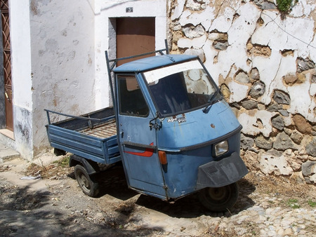 three wheeler: Old three wheeler car in a little village in portugal Stock Photo
