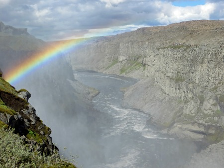 belongs: A start-up rainbow over Dettifoss canyon, Iceland. The canyon belongs to the biggest waterfall of Iceland, Dettifoss Stock Photo