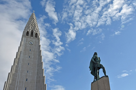 leif: Hallgrimskirkja Church in Reykjavik, Iceland. A special looking Lutheran church looks a bit like Lego land, the architecture inspired by basalt lava flows. It has a sculpture of explorer Leif Eriksson in front of the church. Stock Photo