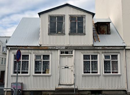 rundown: Run-down old, sheet metal, white house in downtown Reykjavik, Iceland. Eventough it need renovation, It has its own charm.