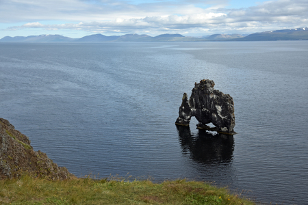 labourers: Hvitserkur basalt stack, a natural sculpture looking like a monster or big gorilla. It sits right on the water at a beach at the fjord or Vatnsnes peninsula in Iceland Northwest. Stock Photo