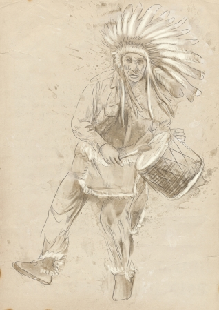 Indian Chief plays the drum and dance  photo