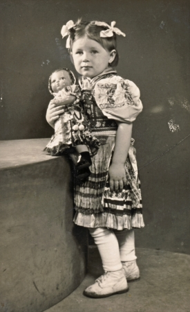 Little girl with dolly - circa 1955  photo