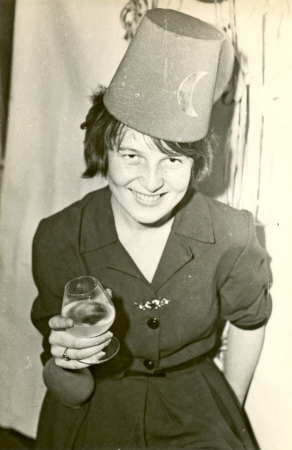 year's eve: New Year s Eve  young woman with a glass of cognac  - circa 1965 Stock Photo