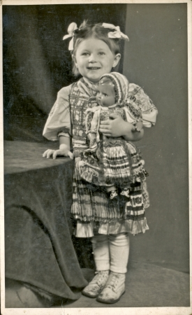 Little girl with doll - circa 1950  photo