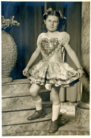 national costume: Girl in national costume with a big heart - circa 1955  Stock Photo