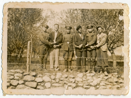 CIRCA 1950  A group of soldiers and men holding hands  photo