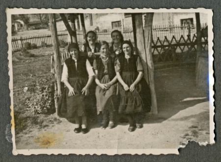 bulgaria girl: CIRCA 1950  Five young women sitting on an old wooden bench  possibly swing  and smile at the photographer