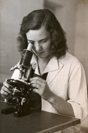 girl with the microscope - photo scan - circa 1950