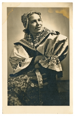 national costume: woman in national costume - circa 1940