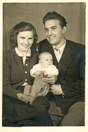 young happy family - circa 1955  photo