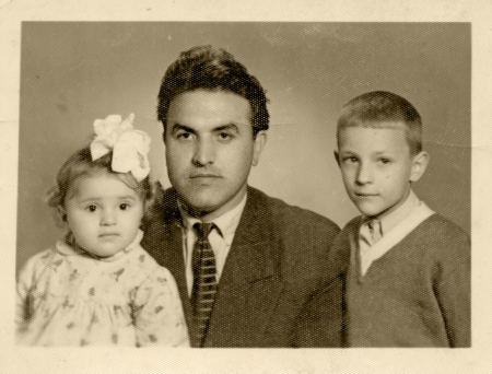 father and his children, son and daughter - circa 1955  photo