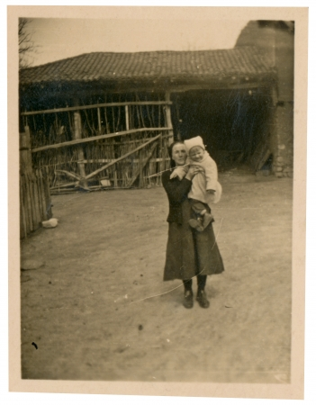 Child and grandmother standing in the yard - circa 1945  photo