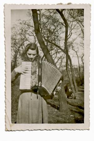 accordion: girl playing the accordion - circa 1947  Stock Photo