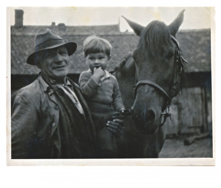 CIRCA 1945 - grandfather, the child and the horse  photo