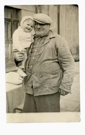 authenticity: PRAGUE, CZECHOSLOVAK REPUBLIC, CIRCA 1950 - Child and Grandpa - circa 1950