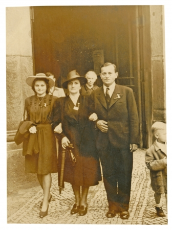 PRAGUE, CZECHOSLOVAK REPUBLIC, CIRCA 1945 - walk through the city, a young family - circa 1945 photo