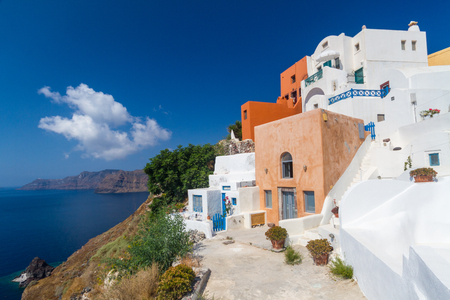 Santorini is characterized by its Cycladic architecture - white painted villages that stand on the top of the high cliffs. Stock Photo