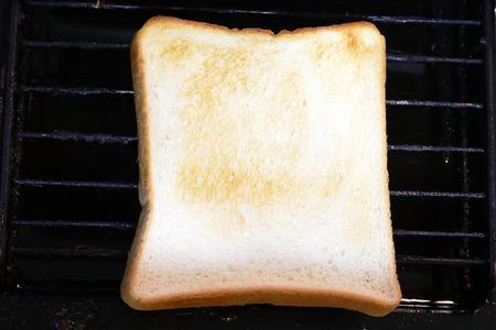 burnt toast: Toast was burnt to moderate.