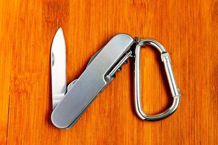 karabiner: Karabiner and outdoor knife. Safety ring with a carabiner and outdoor knife.