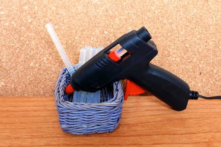 solvent: Glue gun. Tool for bonding, solvent dissolved in an electric...
