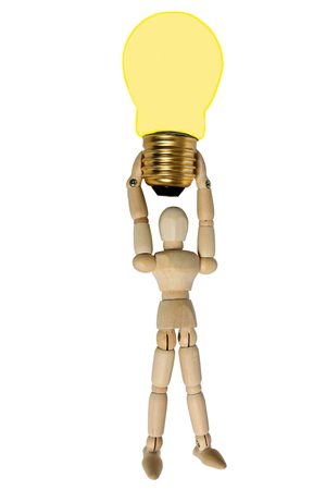 deregulation: Light bulb and a doll. Stock Photo