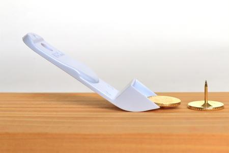 metal tips: Thumbtack remover.