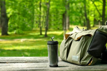 shoulder bag: Water bottle and Shoulder bag. Bag and the bottle on the table. Stock Photo