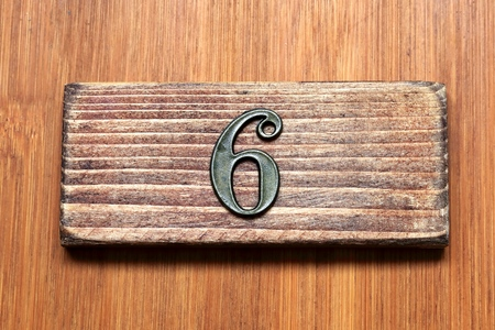 inexpensive: Number 6.Number is inexpensive and mass-produced goods. Number of antique style. I imagined the room number of the door. Stock Photo