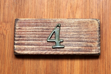 room door: Number 4.Number is inexpensive and mass-produced goods. Number of antique style. I imagined the room number of the door. Stock Photo