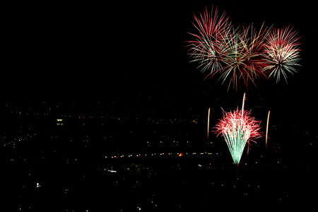 Fireworks display. They were taken to bird  s-eye view from the top of the mountain. Stock Photo