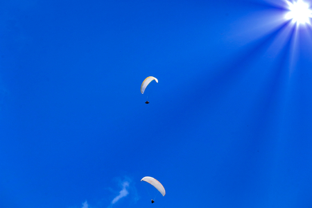airlie: Synthesis of paragliding and sun. Stock Photo