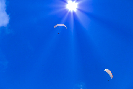 synthesis: Synthesis of paragliding and sun. Stock Photo